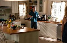 look past the actors to see the beach themed decor of Emily's beach house (more kitchen) tv show -Revenge