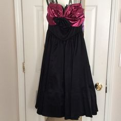 SPRING SALE VINTAGE fancy midi cocktail dress Vintage black cocktail dress with hot pink detail at the bust and fully tulle lined. Worn once, excellent condition! 100% nylon/100% acetate. Gunne Sax Dresses Midi