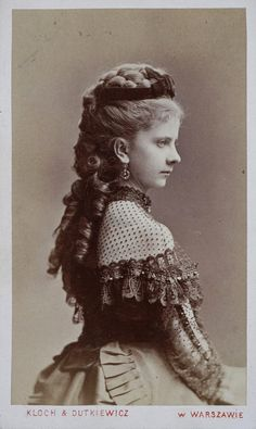 Polish beauty. 1873; Note the off-the-shoulder bodice with the sheer fill-in with a lace neckband. This would be suitable for an Evening or Reception dress for a young woman.