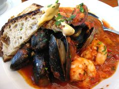 Cacciucco Alla Livornese - Cacciucco is a popular traditional seafood dish with a history that stretches back at least five hundred years. Its name probably comes from the Turkish for 'minute' which is 'kuciuk'.  This fish stew was first made in Livorno around the year 1500. There are many legends and myths surrounding its creation