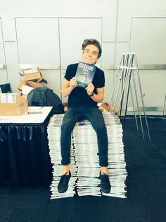 ~Joe with thousands of copies of his book~
