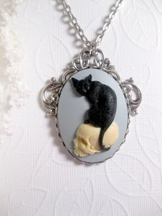 Black Magic Cat And Skull Necklace On Light by FashionCrashJewelry