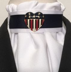 Euro style easy care white crepe with white and navy layered grosgrain pin holder. Very low collar. Velcro closure. Tie has been  made to match red, white, and blue vintage pin 1.25 inches in diameter. Pin is in excellent condition.