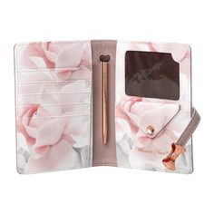 Travel in style with this Travel Document Holder from Ted Baker. With space to hold a passport, several cards and a coins, the interior is completed with an elegant pen to jot down any last minute det