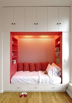 i LOVE this. The bed looks so cozy surrounded on three sides like that and you have room for so many books at your immediate disposal! :0) Then, of course the storage room is awesome. This is just so efficient, it makes me slap-happy.