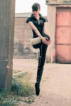 These ballet boots sure do make her legs look long. Very sexy pic.