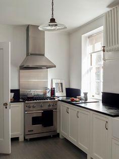 Kitchen in creative director Matthew Axe's Jackson Heights apartment. #remodelista #remodel #kitchen #apartment #smallspace #smallspaceliving