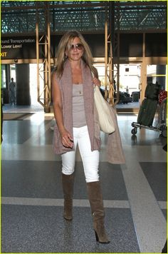 Tan tank and sweater vest, white skinnies tucked in to tall taupe boots
