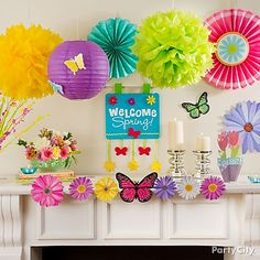 Shower your mantel in spring sunshine with colorful lanterns, fans and flowers! Click to get this look and more Easter decorating ideas.