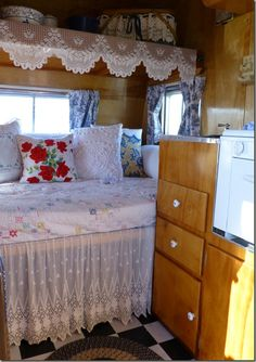I think I might like the barest use of lace in our RV. It softens the heaviness of the generous use of woodwork and keeps it from looking like only men drag their homes around with them.