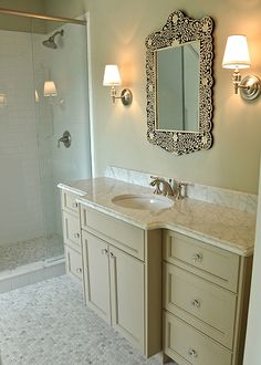 """Gorgeous bathroom with Robert Abbey The Muses Collection 12"""" High Wall Sconces on light taupe ..."""