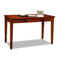 This oak laptop desk is a functional and sophisticated piece of furniture for your home or office. The writing desk is constructed of solid wood and features a flip-down front lid for your keyboard. This desk is the perfect size for any space.