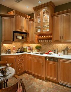 luxury maple  kitchens | Maple cabinets and antique French terra cotta floors blend ...