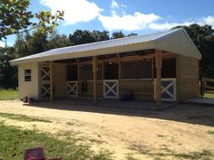 """24'x36' Shed Row Craftsman Barn with 3 - 12'x12' Stalls, 1 - 8'x8' Feed/Tack Room, 8' covered front porch, 24"""" front and rear overhangs"""