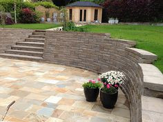 Retaining wall photos, patio wall photos, fence photos and more for great ideas on your next landscape project Walkout Basement Patio, Sunken Patio, Retaining Wall Design, Raised Patio, Front Courtyard, Garden Makeover, Patio Wall, Front Yard Landscaping, Landscaping Ideas
