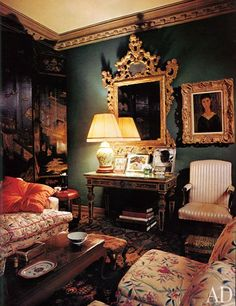 """In the living room of photographer and hostess Jean Howard's Beverly Hills home, Venetian pieces—a carved gilt-wood mirror and a neoclassical console—complement Modigliani's Portrait of Elvira, while an 18th-century lacquer coromandel screen and a porcelain lamp harmonize with the moody, dark-green walls. """"I like people to come into my living room and not be afraid to sit down,"""" Howard told AD in the June 1978 issue."""