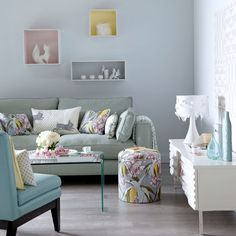 Pastel hues can make a really pretty alternative to neutrals. Soothing shades of blue and green, applied to walls and soft furnishings, give this modern living room a subtle and sophisticated style. Sofa Sofa.com Stool The Dormy House Lamp The French Bedroom Company