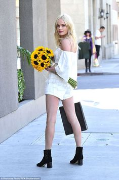 Kate Bosworth looks blooming lovely in flirty white outfit with yellow flowers   Daily Mail Online