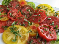 Heirloom tomatoes. Put them on everything and your food is not only delicious, but so colorful! Heirloom caprese salad = to die for.