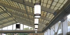 http://www.eclipselightinginc.com/ This pendant is shown hanging at an indoor pool facility.