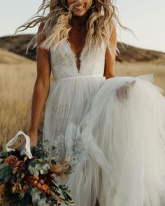 Betony Gown from BHLDN Layers of tulle and lace lend intriguing textural contrast to this boho beauty. At the bodice, gathered tulle straps des. Wedding Dress Black, Pretty Wedding Dresses, Western Wedding Dresses, Wedding Dress Chiffon, Wedding Attire, Bridal Dresses, Bridesmaid Dresses, Lace Dresses, Bridesmaid Proposal