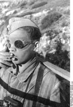 Mussolini's liberation. German paratrooper smoking. Gran Sasso mountain ,Abruzzi , Italy 1943