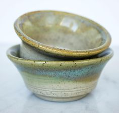 Pair of small bowls with grey clay and mustard and clear glaze. Love the speckles in these! #pottery #ceramics #clay #handmade #handmadeisbetter #ceramica #ceramic #keramik #shoplocal #vancouver #instapottery #potterystudio #iloveclay via: #probeatzpromo