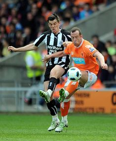 Blackpool 1 Newcastle Utd 1 in April 2011 at Bloomfield Road. Joey Barton and Charlie Adam in action Charlie Adam, Blackpool Fc, Newcastle, Basketball Court, Action, Football, Running, Sports, American Football