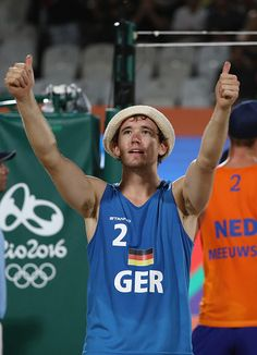Lars Fluggen of Germany waves to the crowd the Men's Beach Volleyball preliminary round Pool B match between Robert Meeuwsen and…