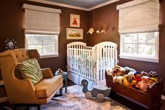 Adorable boy's nursery design with brown walls paint color, white crib, caramel velvet tufted glider, green zebra pillow, blue rug and roman shades. Nursery Room, Nursery Decor, Nursery Ideas, Budget Nursery, Room Decor, Safari Nursery, Nursery Themes, Baby Decor, Bedroom Ideas