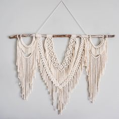 Large macrame wall hanging to hang above your couch or bed! Also perfect for a big empty wall to bring texture and dimension to your room!