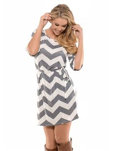 Trendy and light weight slinky gray and white chevron dress features tie waist and 3/4 length sleeves.