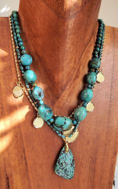 On Trend ~ Layered Necklaces ~ Chinese Turquoise with gold and brass ....... Turquoise helps us communicate our thoughts clearly.