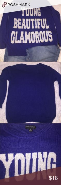 Forever 21+ Young beautiful glamorous sweater Condition: Preowned. Piling through out sweater especially words. See images 3-5 pull on sweater. See images 6. Normal Wear from washing and wearing.   Color: blue/purple   Measurements:underarm to underarm flat; 24 inches. Back of neck Seam to bottom: 29 inches.   Materials: 66% acrylic, 29% nylon/polyamide, 5% wool   Suggested Styling tips: pair sweater with leggings and your favorite combat boots, Forever 21 Sweaters Crew & Scoop Necks