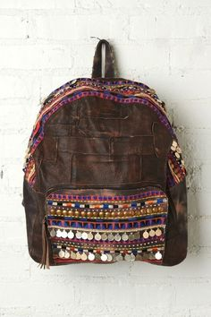 If you are looking for a bag that is going to get some serious jealousy stares from fashion fanatics everywhere, this would be the bag. The destroyed leather and tribal fabric would have been enough to seperate this backpack from all the others, but by adding the embellishment of gypsy coins, the designer hit a whole new level of perfection.