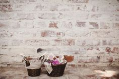 Woven baskets | Brick wall