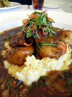 over goat cheese stone ground grits with melted onions, leeks, roasted ...
