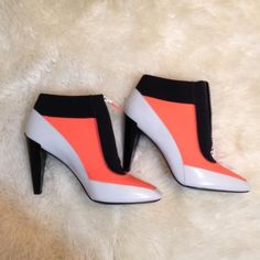 FINAL PRICE DROP KENZO Neoprene Heeled Booties Orange and black is neoprene material. Zip front. Size 10. In excellent condition! Authentic KENZO❌ No trades/No Paypal/No Holds❌ ✅ Bundle Of 2+ Gets 15% Off ✅ ✅ Ships FAST ✅ Kenzo Shoes