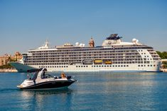 Small and big - Malaga, Spain - April 17, 2018. A small yacht and The World, the largest privately owned residential yacht, in Malaga port, Spain