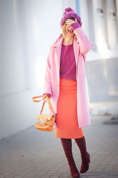 stylish outfit for winter with pink coat and orange proenza schouler bag