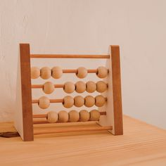 This wooden abacus is a beautiful toy + decor piece in your child's nersary/bedroom. Created with large wooden beads for easy play. Stationery Items, Wooden Beads, Child, Bedroom, Toys, Create, Gifts, Beautiful, Design