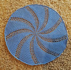 Swirling TARDIS Doily - free crochet pattern (includes a Tardis applique to stitch in the middle) by Erica Bennett