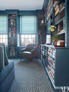 In the library, the tufted armchair is covered in a metallic leather by Edelman | archdigest.com