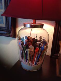 My mama collected swizzle sticks...they stayed in a box in her dresser drawer for 30 years! Now I can proudly display them in this lamp! I smile every time I see it! I love you and miss you mama!