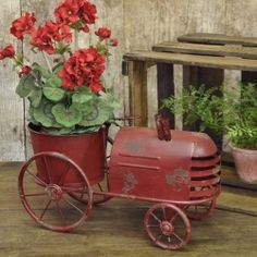 Tractor Planter I can see this outside your house. Does this say Della or what!!??! 9072015