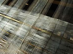 "Kindred Threads | window transparency: double weave + spaced warp | linen + silk + stainless steel + Big Bluestem grass | 76""x 20-1/2"" woven width; 25"" width with prairie grass | Viroqua, Wisconsin, U.S.A. | c. 2013"