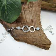 Sterling Silver Infinity Knot Bracelet with Aquamarine. Adjustable Fit £18.00