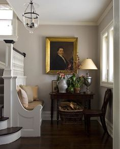 Traditional decor in this entry with built-in bench, oil painting, and magnficient timeless style.