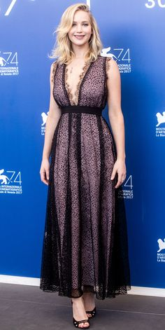 Look of the Day - JENNIFER LAWRENCE from InStyle.com Jennifer Lawrence also attended the Venice Film Festival in a jaw-dropping look. The award-winning actress wore a romantic plunging lace gown, ultra-feminine ankle-strap heels, and delicate jewelry.