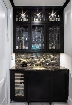 Chic black wet bar boasts white walls lined with black crown molding complementing black cabinets fitted with a built in glass front wine fridge and a black and. Home Wet Bar, Diy Home Bar, Home Bar Decor, In Home Bar Ideas, Wet Bar Cabinets, Black Cabinets, Upper Cabinets, Kitchen Cabinets, Bar Cabinets For Home